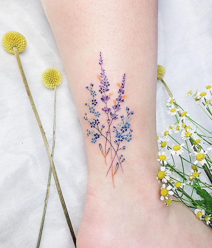 Blue And Violet Wildflowers Inked On The Ankle