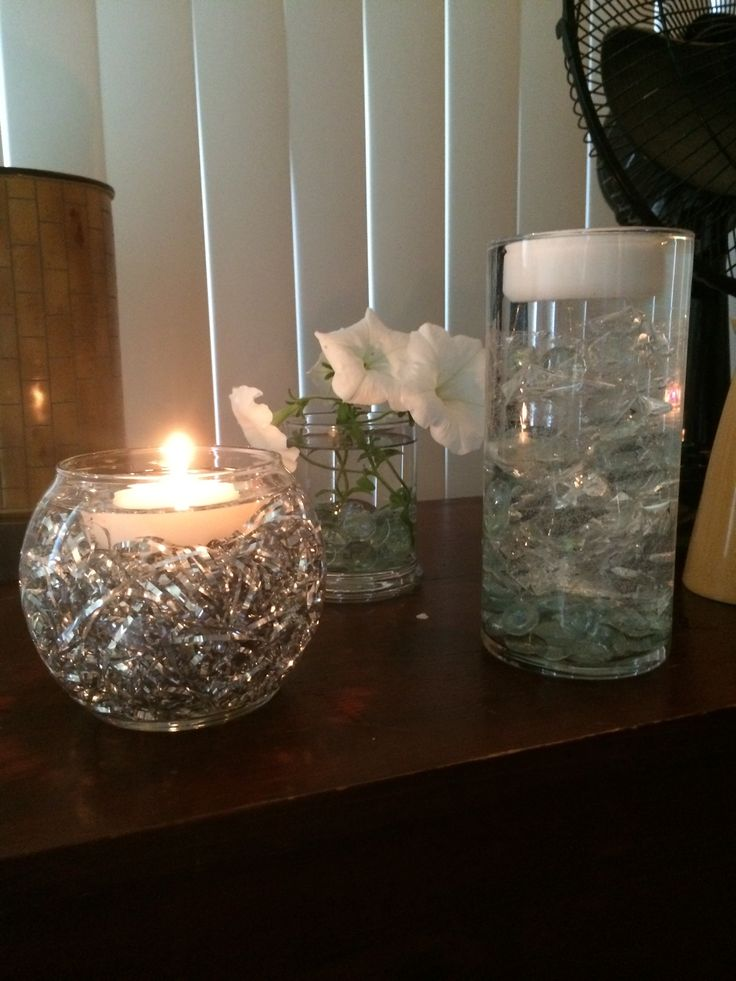 Silver tinsel and cellophane submerged in water with floating candle  Crafting my Wedding
