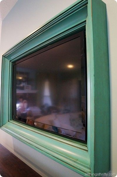Picture frame around TV. Love this!!!!                                                                                                                                                      More