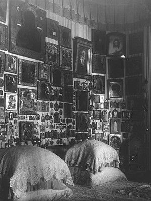 The bed faced the window, behind it were hundreds of ikons and religious items which were hung on cords. Many of the ikons were ancient and valuable. The centerpiece was a large ikon of the Feodorovsky Mother of God - an ancient copy of the ikon used to bless the first Romanov Tsar when he accepted the throne.