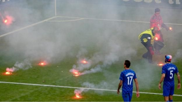 Play is stopped during the Euro 2016 Group D match between Croatia and Czech Republic as flares are thrown on to the pitch.