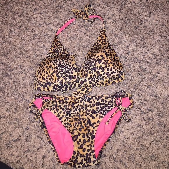 VS bikini top and bottom Cheetah print VS bikini top with removable padding and bottom. Top size 34B bottom size small. Victoria's Secret Swim Bikinis