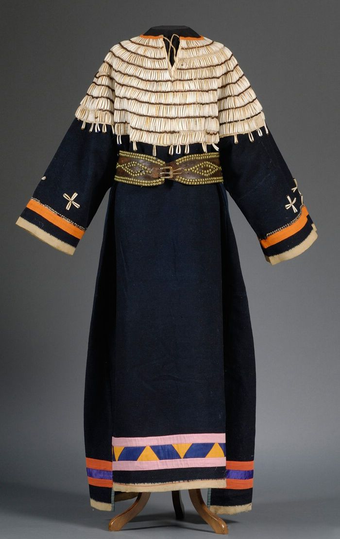 Plains Blue Trade Cloth Woman's Dress, Lakota, c. late 19th century. Muslin-backed yoke with rows of dentalia shells and bugle beads, with ribbon applique decoration along bottom