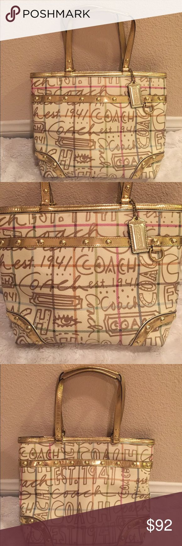 Beautiful Gold Coach Tote🌟 Beautiful authentic Coach Tote in excellent condition, shows no signs of wear inside a beautiful hot pink and in perfect condition! Tote has one large pocket on front of Bag and one large pocket in back of Bag, it measures 14 inches wide and 11 inches tall, thanks for looking 😊 Coach Bags Totes