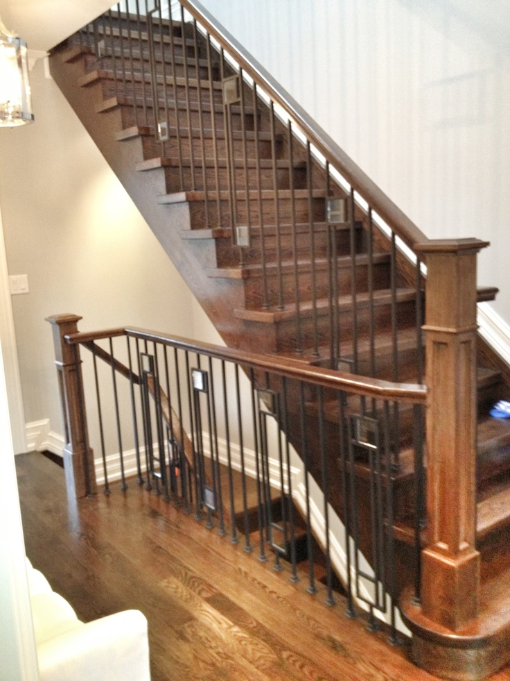 Modern style iron railing with clear glass inserts. Rift ...