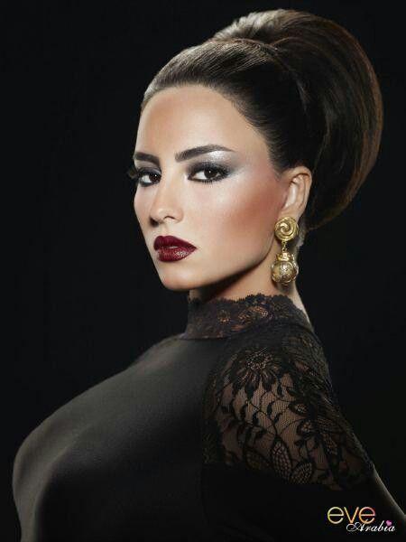 Smokey Lebanese + Dark Lips Makeup. Never mind the fake boobs!