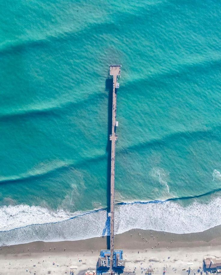 Check out this incredible drone shot of waves rolling into the pier in San Clemente, California. The structure extends nearly 1300 feet (396 meters) into the Pacific Ocean and is a popular destination for surfers.  Instagram: http://bit.ly/2yh8PyF  Drone shot by Nick Hartman