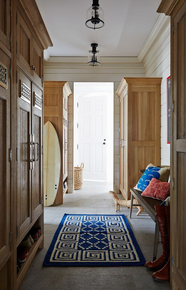 mudroom lighting. beach cottage mudroom features oak cabinets accented with shelf for shoes across from slatted bench alongside blue greek key rug lighting