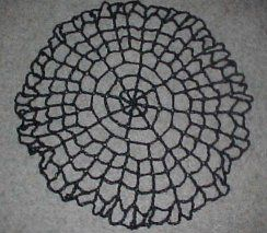 Corner Web from Message board adapted from Halloween spiderweb table topper crochet pattern - here.  Looks good in black too.  Wondering if clear beads could be added to emulate due drops?