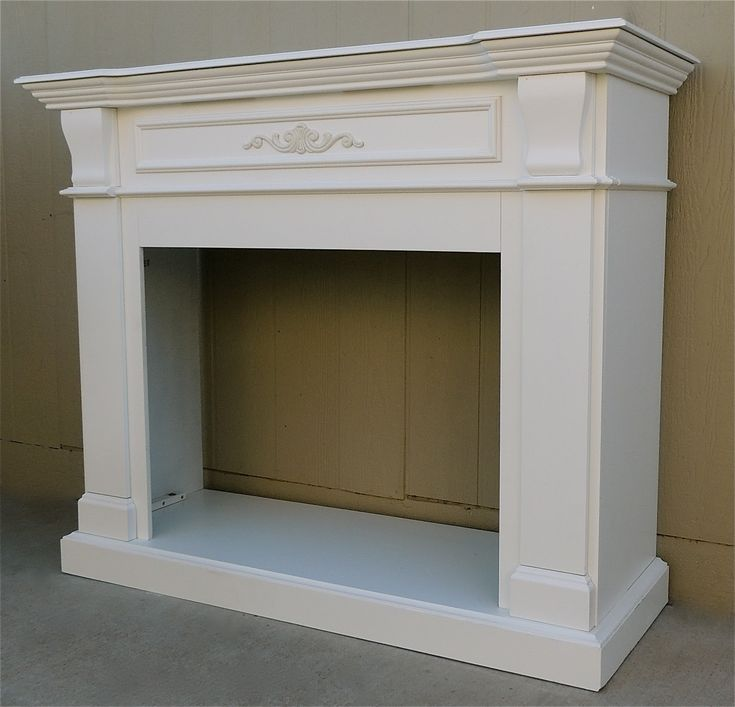 """For sale is a beautiful fireplace mantle that has been painted a crisp white. It measures 56"""" wide x 21"""" deep x 48"""" high. This free-s..."""