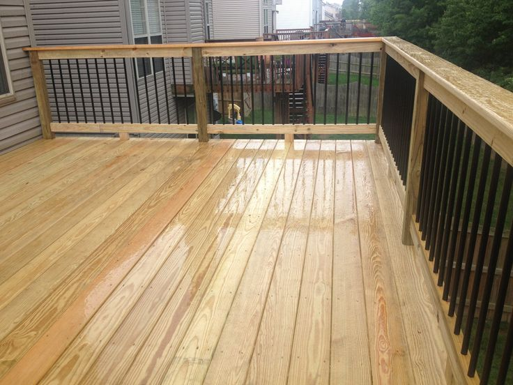 Black Metal Aluminum Spindles on 12x16 deck with premium wood decking