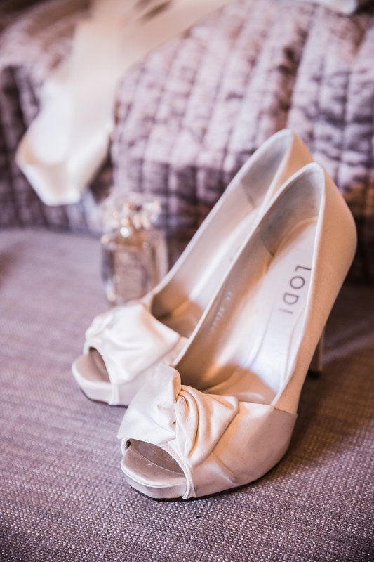 Nice wedding shoes!  Photo By FOTOZEE