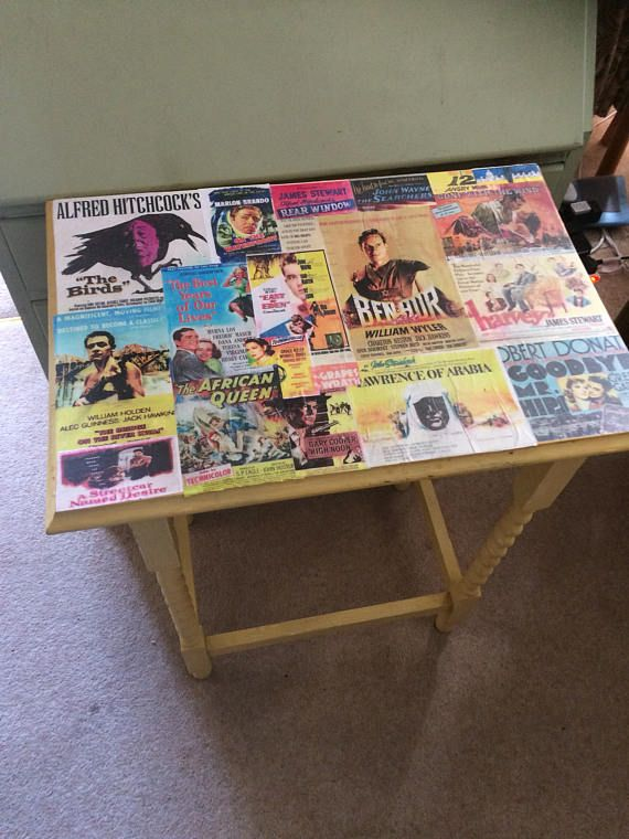 For sale 1930s distressed occasional table updated with decoupage depicting blockbuster movies. The table frame has barley twist legs and is chalk painted ( mustard)The table top is warped adding to its individuality.     Dimension  Height 75 cm  Length 59 cm  Width 40 cm      Welcome to WeLoveItShop:    We are confidient that you are aware that buying and selling of antiques is one of the oldest forms of recycling there is. People for centuries have been   buying, selling and passing on…