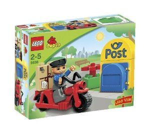 LEGO Duplo Legoville Postman (5638) by LEGO. $6.49. DUPLO pieces are colorful, sturdy and fun to spark younger builders' imaginations. Contains nine pieces. Includes post box, motorbike, postman figure, 'package' brick, and flower. Mailbox with simple functions as posting a parcel and emptying the mailbox. Build and re-build new adventures every day. From the Manufacturer                The postman drives around on his motorbike checking the mailbox and delivering the m...