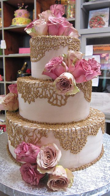 3-tier Wicked Chocolate wedding cake iced in caffe latte chocolate ganache, with piped brown crochet-style lace designs, fresh pink & antique style roses