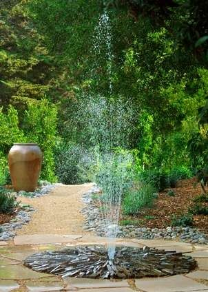 Pondless fountain in the patio.  Simple to create with an underground water reservoir and steel safety grid.
