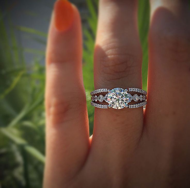 This diamond engagement ring created by Simon G features 0.91ctw diamond accents. Available in platinum, 18k yellow, or rose gold, this setting is absolutely perfect for any women who values elegance and beauty. Surrounded by a diamond shank the center is available to accommodate any size stone.