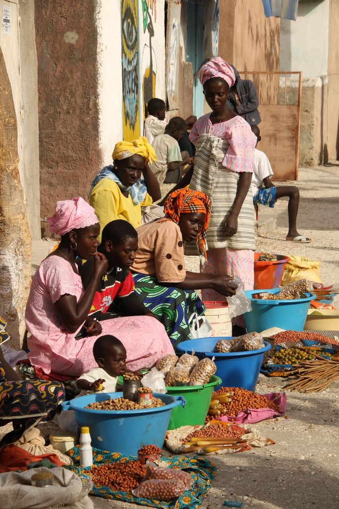 ˚Street market with women selling all kinds of nuts - Africa