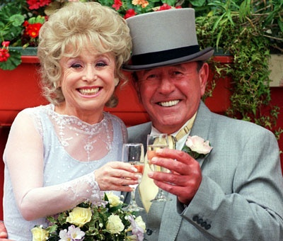 Eastenders:  Frank Butcher married his childhood sweetheart June and had four children. However the great love of his life was second wife Pat Wicks.   Peggy married Eric Mitchell, the father of her children Phil, Grant and Sam. Years later, romance blossomed between Frank and Peggy and they tied the knot. But it didn't last.