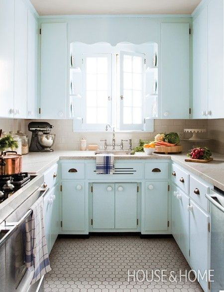 Lovely kitchen remodel using existing 1950's cabinets (painted a soft blue), and replacing the appliances, flooring, and countertops.