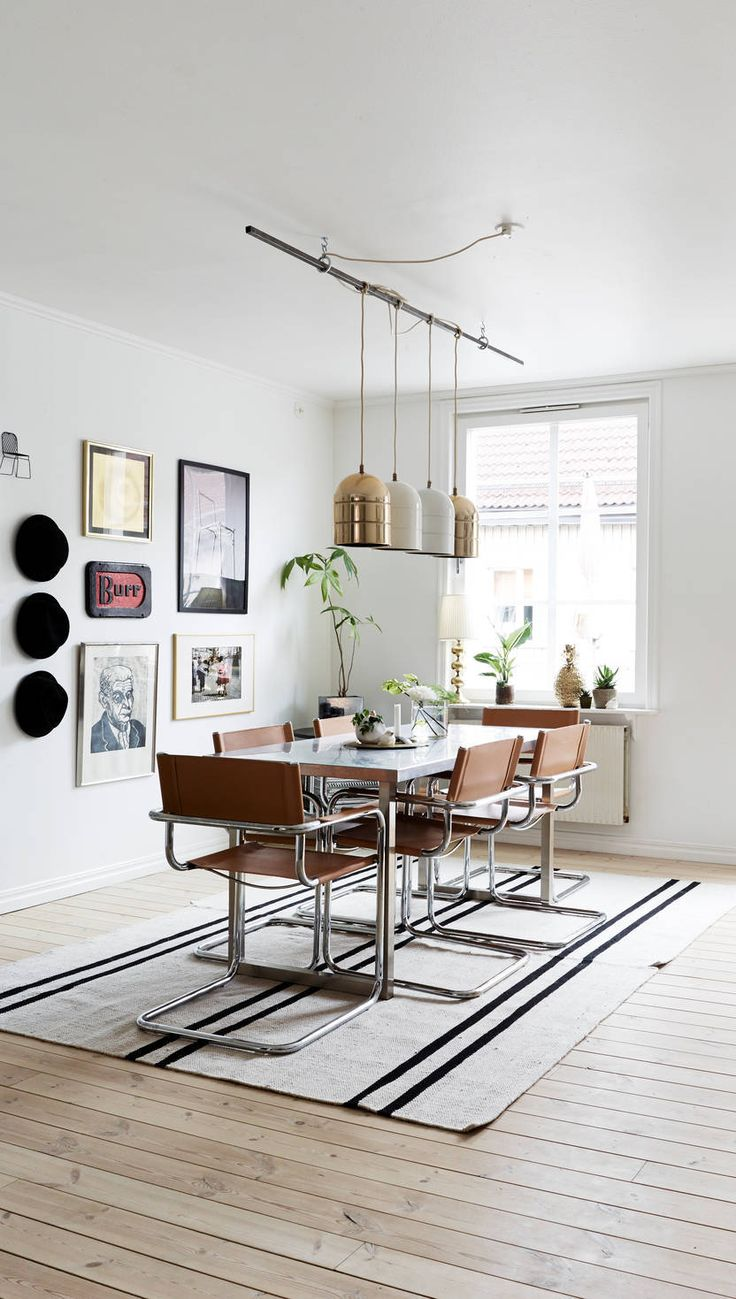 via Coco Lapine Design white walls leather chairs lighting pendants picture frames