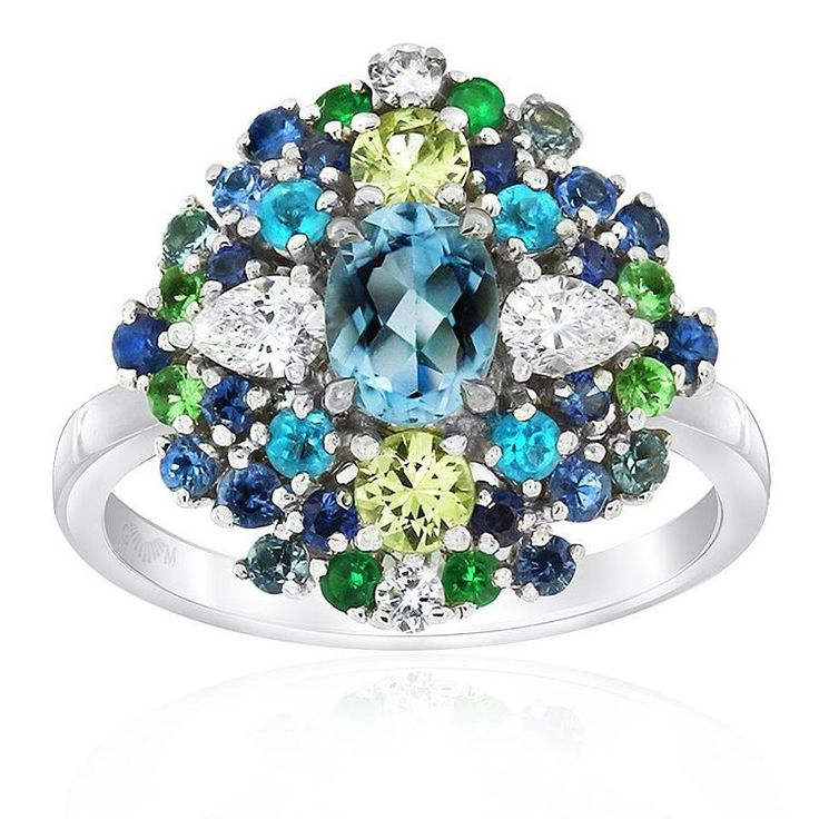 Be spellbound by this spectacular Cirque ring crafted in 18ct white gold and featuring chrysoberyl, tsavorite garnet, apetite, sapphire and aquamarine gemstones and diamonds by Gerard McCabe.