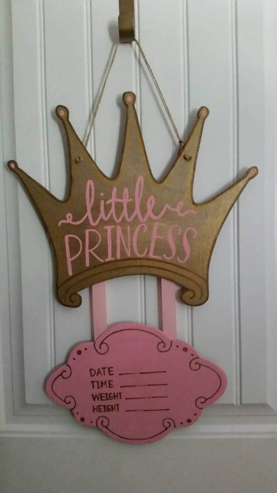 This customized antiqued crown is the perfect hospital door hanger to welcome your new princess! It can also be used as a baby shower decoration or add a personal touch to your new bundles nursery wall/on the door. Item is made of wood, hand cut and sanded, hand painted, and sealed with a protective finish. Please include the name or phrase you want used in the notes to seller. All items are painted black on back. Each item is custom and hand painted, so variations should be expected...