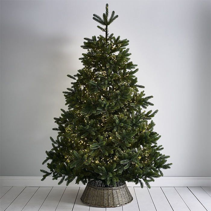 The Best Artificial Christmas Trees From Marks Spencer Ikea And More Best Artificial Christmas Trees 9ft Christmas Tree Wicker Christmas Tree Skirt
