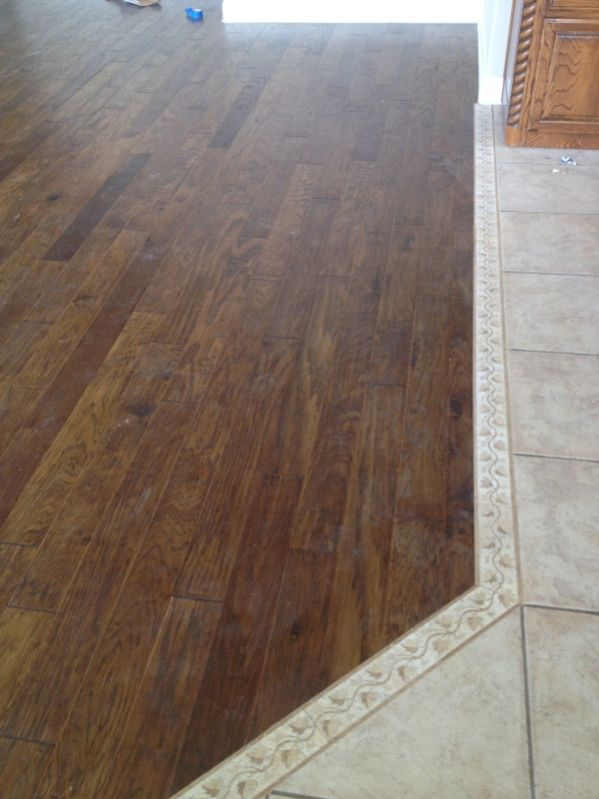 Tile to wood floor transition tile to hardwood for Flooring transition from kitchen to family room