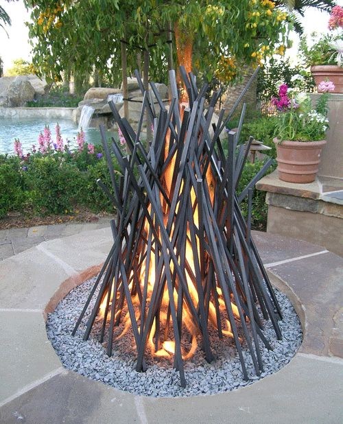 This outdoor 'Fire Pit' looks like a traditional bonfire, but it's made of steel and set into a bed of chippings. It's by Cathy Azria of http://www.bd-designs.co.uk/