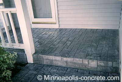Overlay your existing porch and stairway - An overlay is a thin layer of new concrete poured over your existing concrete to make a new surface. Many choose to do this because they want the look of a stamped and colored porch, but don't want the expense of tearing out their existing, structurally sound concrete. If your concrete has a lot of cracks, though, there is no guarantee that the cracks won't show through the overlay.