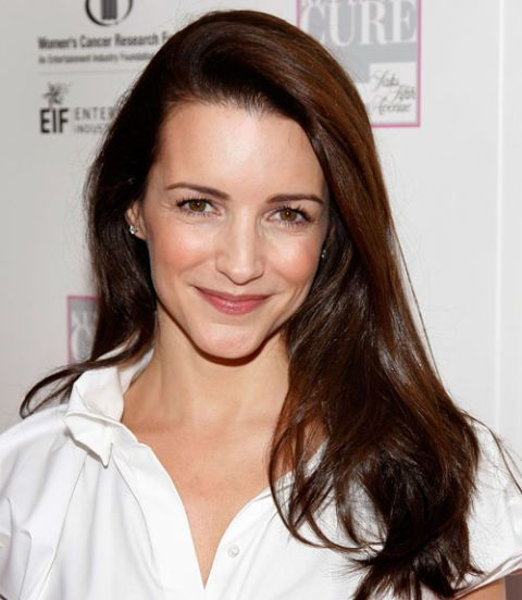 For lots of volume with minimal effort, try Kristin Davis's trick and pull the majority of your hair to one side.