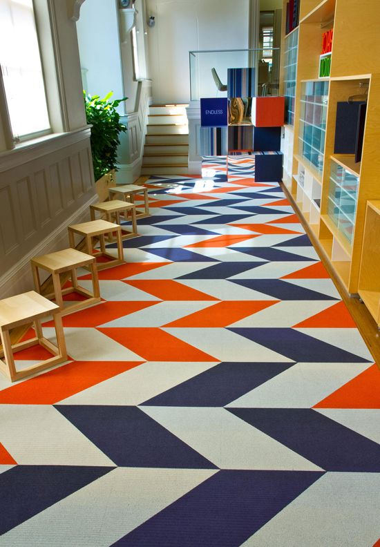 Use carpet tiles to make funky designs for a rug. Cheap and creative!
