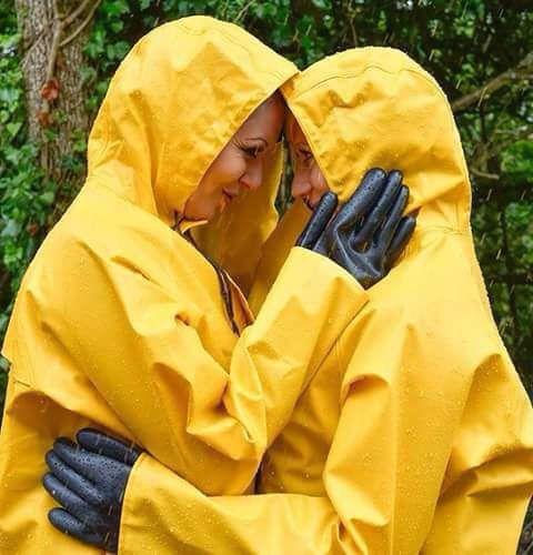 Yellow raincoats rainwear loving couple.