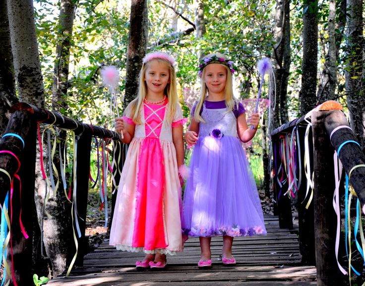 The Pink Princess Dress and the Lilac Flower Tulle Dress, with matching tulle wands and flower garlands