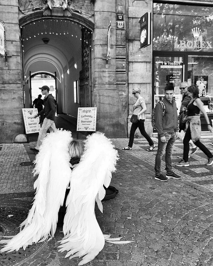 Angels in Prague  #prague #travel #afternoon #wenceslas #square #angels #wings #street #streetphotography #galaxys6