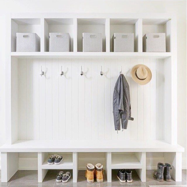 Mudroom necessities! Storage, hooks, and a bench! | Designed by Shari Lerner, Built by @jordyndev1, Photo by @stephanibuchmanphoto #lernerinteriors #interiordesign #mudrooms