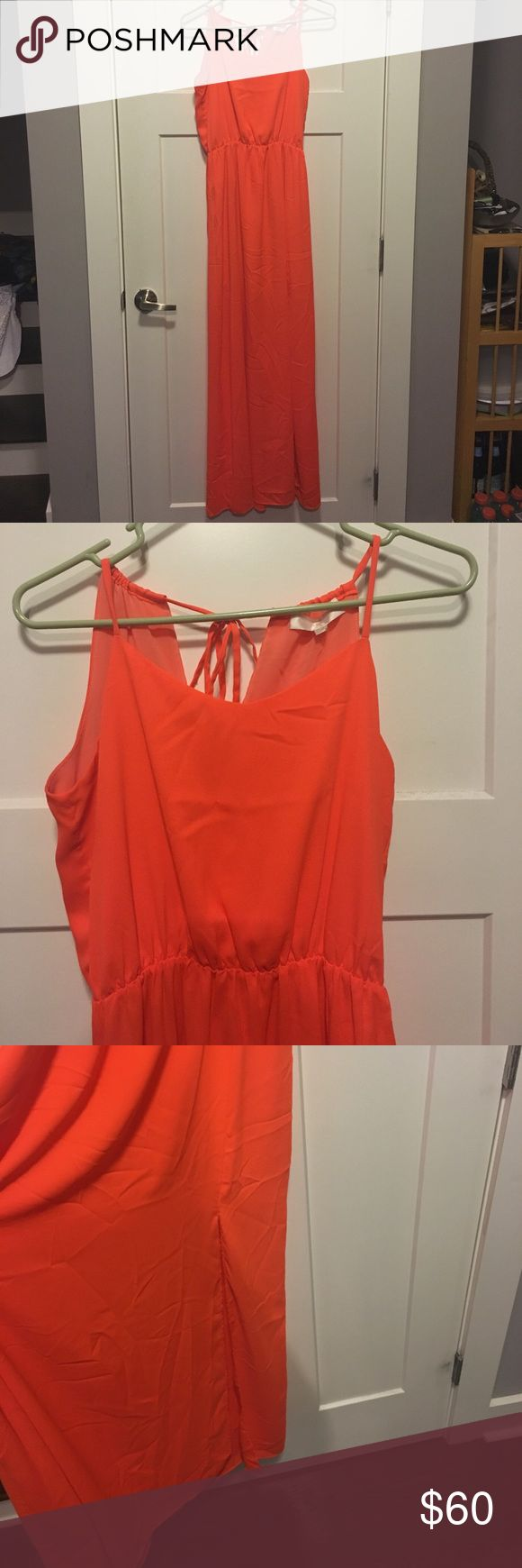 Bright orange maxi dress MM Couture Size small. Bright and fun maxi with a small slight on the left leg. Worn only a few times. Wrinkled from storage. Adjustable in the back with tie. MM Couture Dresses Maxi