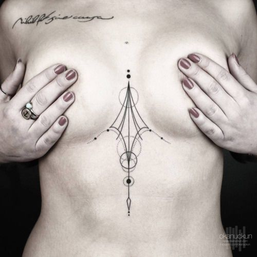 Geometric sternum piece and collarbone tattoo saying...
