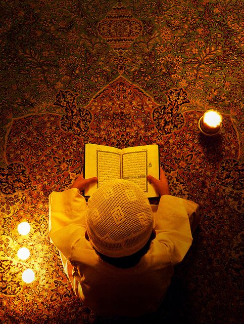 little boy reading quran