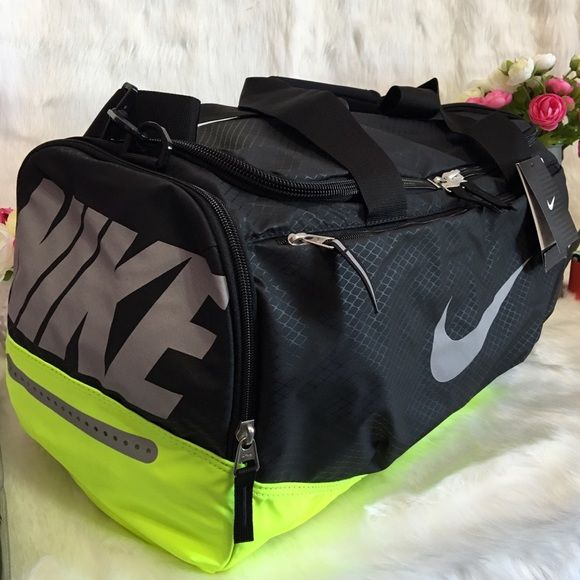 NIKE MAX AIR Duffel Bag Color: black/volt/metalluc silver.  This nike elite bag is dependable duffel, and its water-resistant. It is also durable, stylish, and ready for you to bring to your next big game. Breathable Max Air shoulder straps are padded for support. Straps are made of polyester webbing for durability. Mesh pockets, both zippered and stash, provide ample storage. Internal pocket provides secure small item storage. New w/ tag. Nike Bags Travel Bags