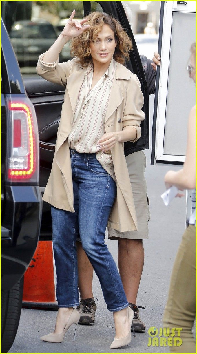 Jennifer Lopez waves to some fans while on the set of her upcoming series Shades of Blue on Thursday (July 23) in New York City.