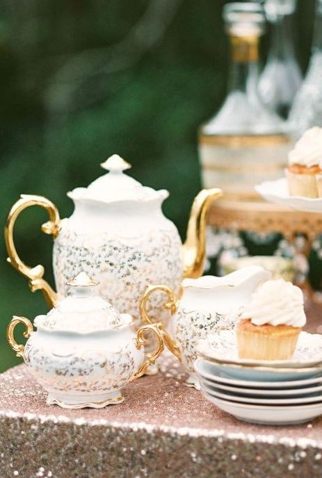 Beautiful white and gold tea service. Good contrast with outdoors.