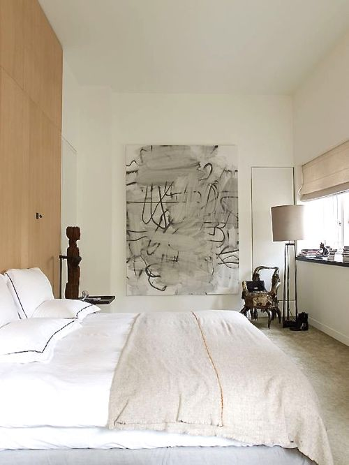 Neutral Bedroom With Abstract Artwork