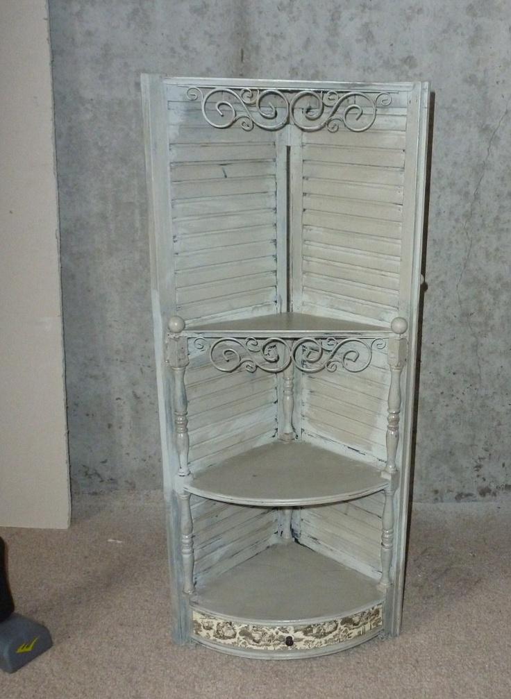shutters made into a corner shelf