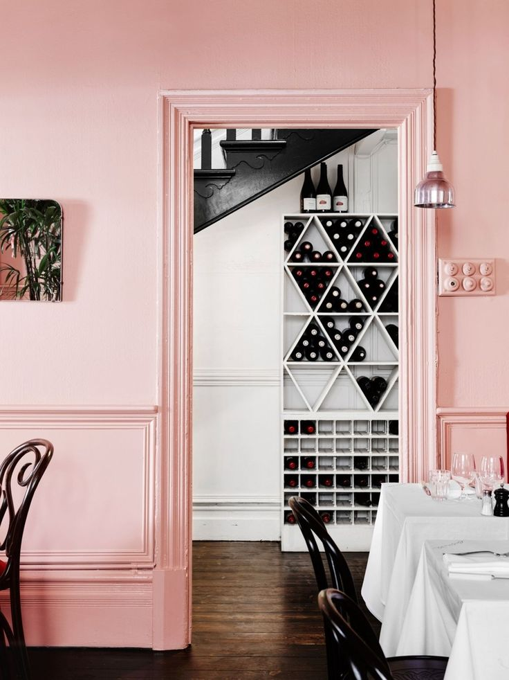 Quit fiddling around with 'accent colour' and be brave; a gentle shade it may be, but pastel pink can still pack punch if used in a bold way. Nothing says confidence like taking wall colour over door frames, skirting boards, even light switches – and this dining space pulls it off in spades. Go for dark wood floors and a crisp monochrome palette elsewhere for contrast