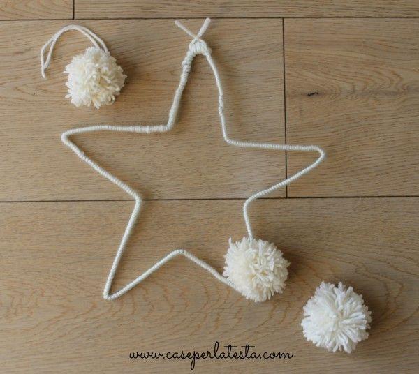stella di lana fatta con una gruccia metallica