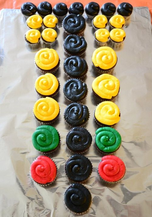 Instead of a birthday cake, cup cakes can be used to create a Christmas Tree from the starting line.
