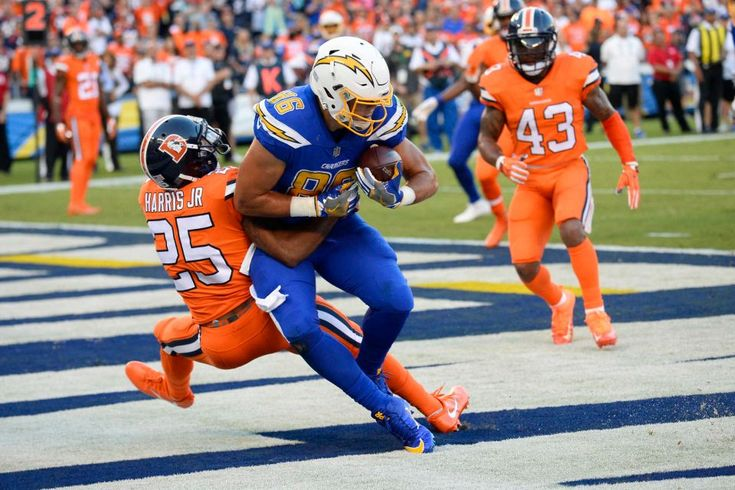 Broncos vs. Chargers:   October 13, 2016  -  21-13, Chargers   -     Broncos vs. Chargers:   October 13, 2016  -  21-13, Chargers   -     San Diego Chargers tight end Hunter Henry (86) makes a touchdown catch as Denver Broncos cornerback Chris Harris defends during the first half of an NFL football game Thursday, Oct. 13, 2016, in San Diego.