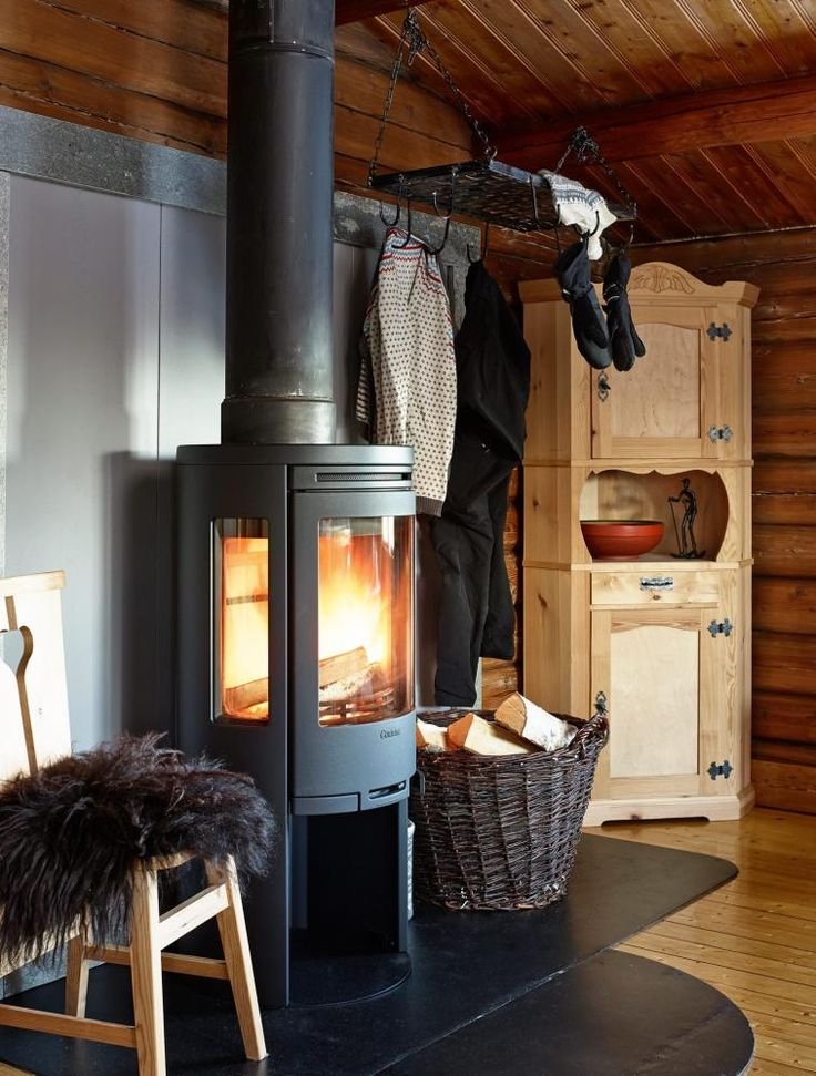 Fireplace in a cosy Norwegian cabin without electricity and water.